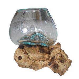 glass blown on driftwood
